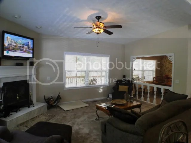 The home has large rooms, big windows, wood-burning fireplace and a cozy feel, Bald Head the Realtor, John Becker